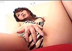 Oriental nympho Ruka Uehara enjoys tickling her hairy pussy for satisfaction