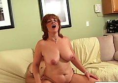 Sexy redheaded MILF gets cum on her big tits