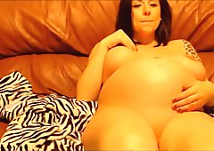 Pregnant beauty fingers watching porn