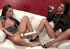Peppering brunette lesbian gets her shaved pussy tickled with vibrator
