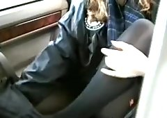 Undressing and flashing in the back of a car