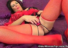 British milf Lulu Lush is wearing fishnet stockings and high heels