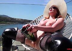 Mature Red XXX fucks a champagne bottle outside